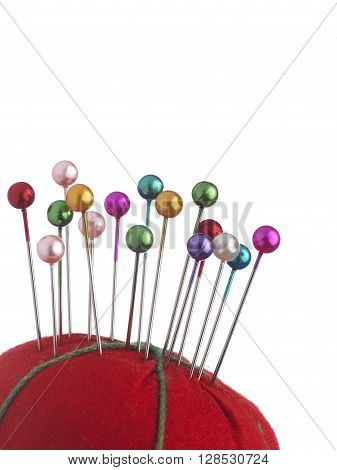 Pushpin and pin cushion isolated on a white background