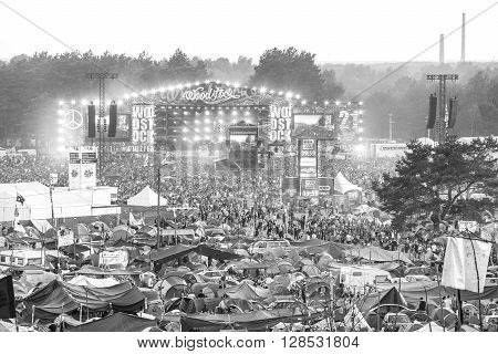 Kostrzyn nad Odra Poland - August 1 2015: Black and white picture of main stage and tents at the 21th Woodstock Festival Poland (Przystanek Woodstock).