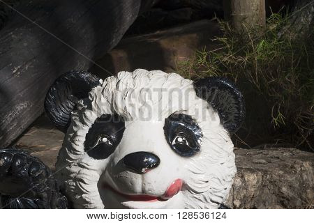 Wooden sculpture of panda in the park