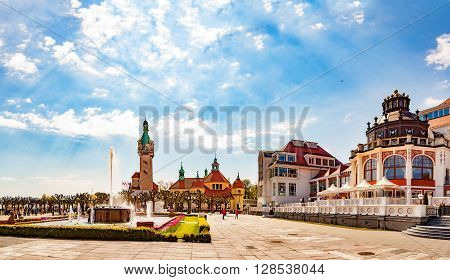 SOPOT, POLAND - MAY 03, 2016: People relaxing on square near famous pier in Sopot. Sopot is a famous tourist resort located in Poland.