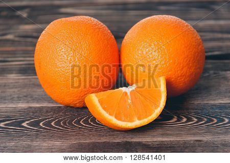 Orange, Orange Lobule on the Wooden Table. Healthy Lifestyle Concept