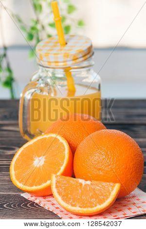 Orange, Half of Orange, Orange Lobule, Jar of Juice on the Wooden Table. Healthy Lifestyle Concept