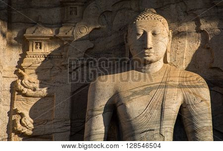 POLONNARUVA, SRI LANKA - May 01 2016 : Buddha statue face on yellow stone wall at Gal Vihariya on December 24 2015 in Polonnaruwa, Sri Lanka