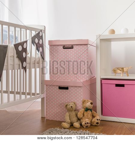 White Cot And Pink Boxes