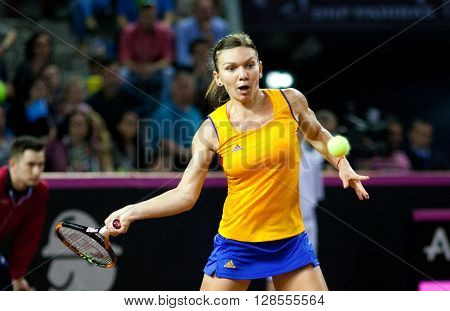 CLUJ-NAPOCA, ROMANIA - APRIL 17, 2016: WTA 6 ranked woman tennis player Simona Halep plays against Angelique Kerber during a Fed Cup Play-Offs Tennis match, Romania vs Germany