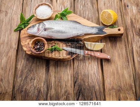 Seabass fish on the graphite board.