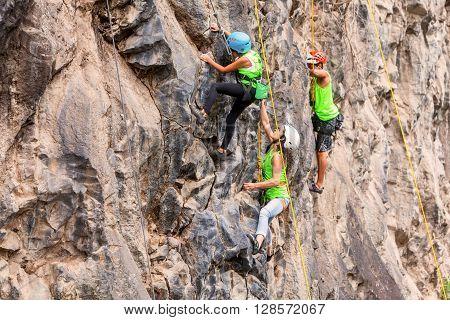 Banos Ecuador - 30 November 2014: Basalt Challenge Of Tungurahua Group Of Brave Climbers Climbing A Rock Wall In Banos On November 30 2014