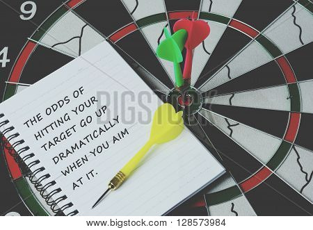 inspirational quote about target in life with darts on bulls eye retro style