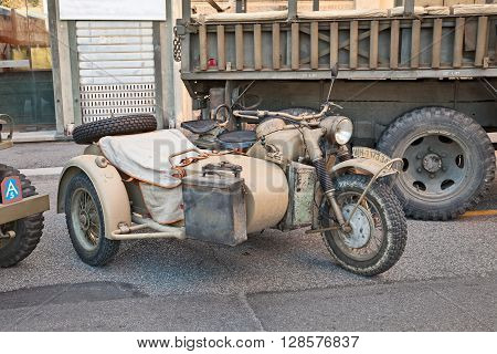 FAENZA ITALY - NOVEMBER 2: old motorcycle with sidecar made in Germany BMW R75 750 cc World War II era in military vehicle rally during the festival