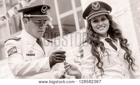 Banos De Agua Santa - 29 November : Black And White Portrait Of Young Woman And Man Wearing The Uniform Of Navy In Banos De Agua Santa On November 29