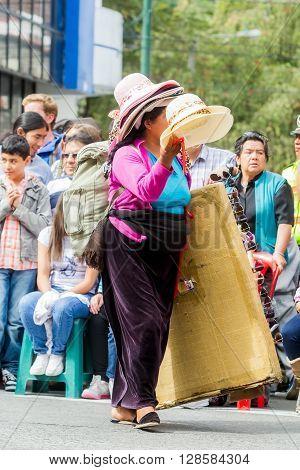 Banos De Agua Santa - 29 November, 2014: Hat Seller Woman On The Street Of Banos De Agua Santa, Ecuador, South America On November 29, 2014