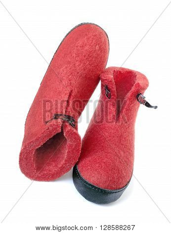 Pair of felt boots bright red on a white background