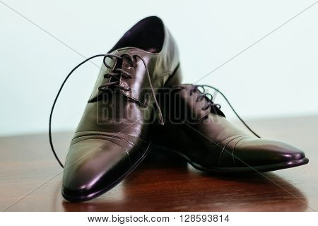groom tying shoe laces groom hand shoes