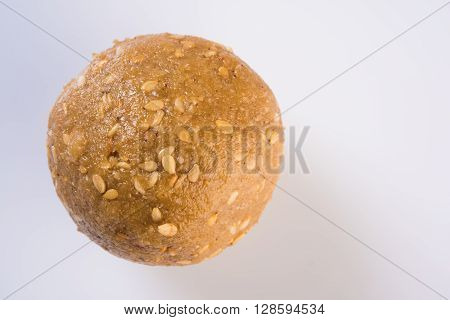 isolated tilgul laddu or laddoo or til gul laddu, showing texture on white background, top view closeup