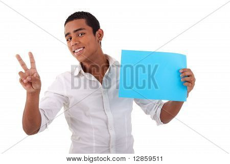 Happy Young Latino Man, With Blue Card In Hand, Fingers As Sign Of Victory, Isolated On White Backgr