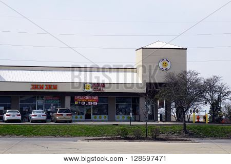 NAPERVILLE, ILLINOIS / UNITED STATES - APRIL 18, 2015: People may eat at the Chataka Masti Indian Grill, and shop for groceries at the Zem Zem Market, in Naperville.