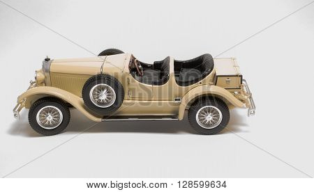 beautiful amazing closeup view of retro vintage classic car isolated on light grey background