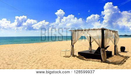 Beach cabana on sand facing open sea