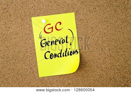 Business Acronym GC General Conditions written on yellow paper note pinned on cork board with white thumbtack copy space available poster