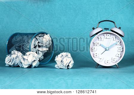 retro and vintage style of Old fashioned the alarm clock and clumpled peper waste idea