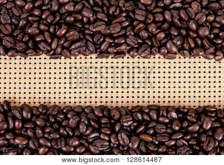 the coffee beans border on wickerwork background