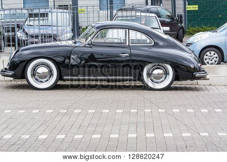 VELBERT NRW GERMANY - APRIL 06 2016: Black vintage  car 1600 with whitewall tires on a car park in Velbert city center Germany.