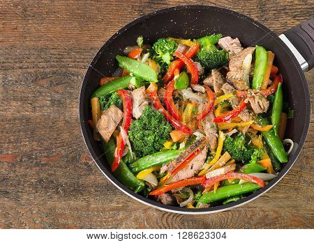 Beef Vegetables Stir Fry On Wooden Table.