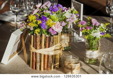 Wedding rustic table full of wild flowers and and country decoration ** Note: Soft Focus at 100%, best at smaller sizes