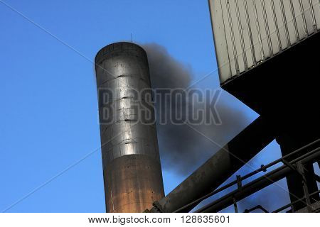 Smoke from industrial chimney escaping to atmosphere.