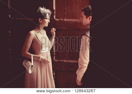 Pretty Couple On The Vintage Doorway Background. Retro Styled Toning.