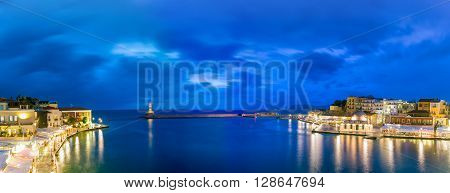 Picturesque panoramic view of old harbour of Chania with Lighthouse and Kucuk Hasan Pasha Mosque during twilight blue hour, Crete, Greece poster