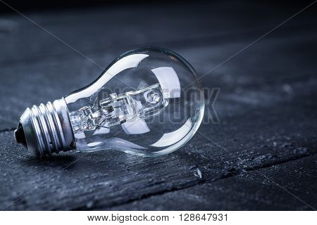 Tungsten bulb on a black wooden table