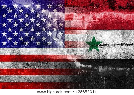 USA and Syria Flag painted on grunge wall. Vintage and old look.