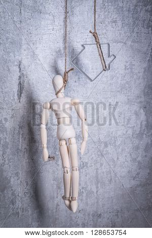 Wooden Figure Of Human And House In A Hangmans Loop