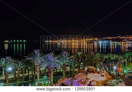 EILAT, ISRAEL -  A look at the bay of Eilat and the port from the hotes area, at night