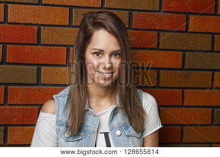 Teen Girl Against Wall