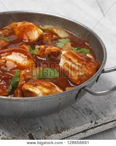 Chicken Curry in a Balti dish on a table top