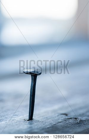Old Rusty Nail In The Wooden Plank Over The Window