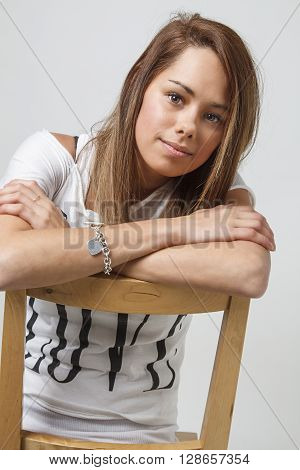 Portrait In A Chair