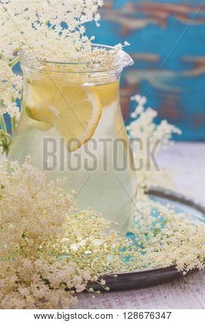 Elderflower cordial., close up. Home made refreshing elderflower  lemonade  on a wooden table. Macro, selective focus, vintage toned image