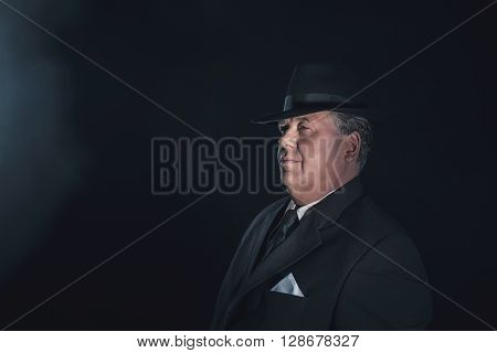 Vintage 1930S Gangster Wearing Hat. Classic Studio Portrait.