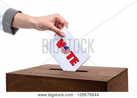 Human hand inserting bulletin in ballot box isolated on white poster