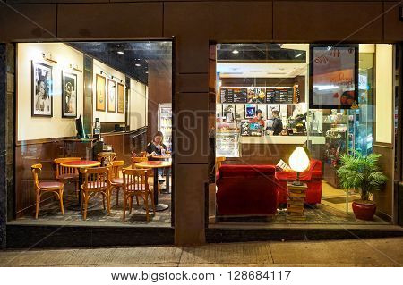 HONG KONG - JUNE 03, 2015: Pacific Coffee cafe at night. Pacific Coffee Company is a Pacific Northwest U.S.- style coffee shop group originating from Hong Kong