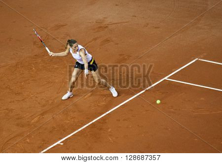 CLUJ-NAPOCA, ROMANIA - APRIL 17, 2016: German tennis player Andrea Petkovic plays against Monica Niculescu during a Fed Cup match in the World Cup Play-Offs Romania vs Germany