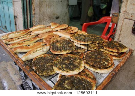 An open air market stall with pita breads in the Christian quarter of Old Jerusalem, Israel.  Also known as the Muristan.