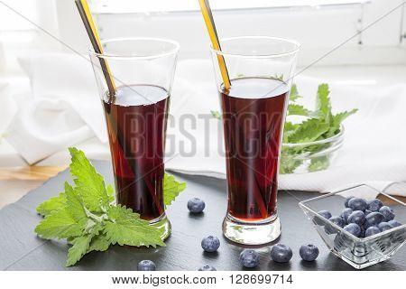 Glasses With Fresh Black Currant Juice. Bog Blueberry And Lemon Balm