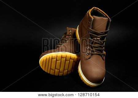 Stylish Brown Nubuck Mens Boots On Black Background, Advertising Concept