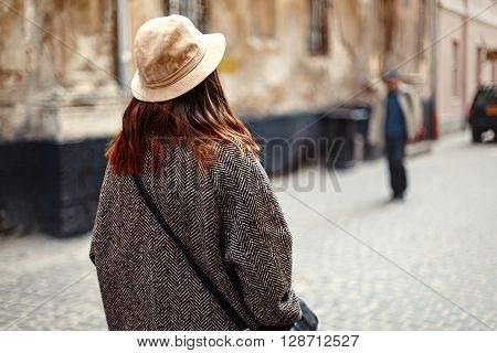 Happy And Stylish Pretty Hipster Woman Walking On Background Of Old Streets In European City, Travel