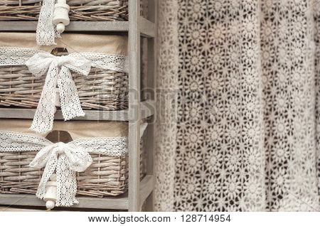 View of wicker basket and nice crochet curtain