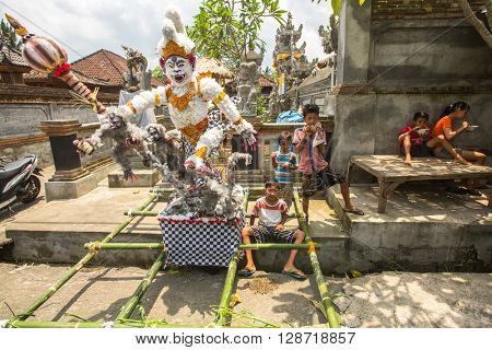 UBUD, BALI - MAR 8, 2016: Unidentified people during the celebration before Nyepi - Balinese Day of Silence. Day Nyepi is also celebrated as New Year - according Balinese calendar now came 1938 year.